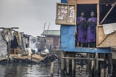 Beauty salon by Petrut Calinescu, Lagos, Nigeria. Flood, fire and Fukushima: environmental photographer of the year 2015 – in pictures Planet Pictures, Powerful Pictures, Concours Photo, Climate Change Effects, Photo Report, Hair And Beauty Salon, Photography Competitions, Environmental Issues, Slums