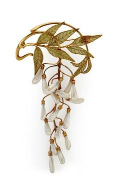 Vever | 18k yg. articulated brooch with plique-à-jour enamel foliage and dogtooth pearl wisteria blossoms, ca. 1900. Attrib. to Vever, possibly after a design by Rene Lalique. Provenance: From the Collection of Dora Jane Janson. Literature: Janson, Dora Jane. From Slave to Siren. The Duke University Museum of Art. 1971.