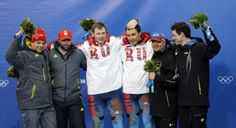 Sochi Olympics Bobsleigh Men- USA-1 takes bronze and pose with Russia and Switzerland after the men's two-man bobsled competition. http://trib.com/sports/olympics/winter-games/photos-u-s-jamaican-bobsled/collection_ede4e42b-c3da-58da-8fb8-3bdc6bdc8dca.html#1
