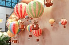 Hanging hot air balloons. These are our favourite mobile alternative. Floating high in the sky of a nursery or bedroom, a single balloon, or a collection of a few favourite colours adds inspiring whimsy to any space. Available at Dilly Dally Kids.