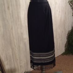 """Pretty fringed skirt Black with fringe. Detailed embroidered bottom section with white. Side button closure, is wrap around style. 28 """" waist. Waist could be adjusted by moving button. Fringe is 3"""" long. Skirt length is 33"""". Rayon for easy care. Is soft like cotton. Excellent condition. Coldwater Creek Skirts"""