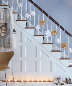 Moravian stars, ribbons, and lights for staircase. I love this simple, clean look.