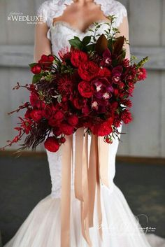 "Ultra Posh ""All Red"" Wedding Bouquet Which Includes: David Austin English Garden Roses, Pin Cushion Protea, Cymbidium Orchids, Additional Florals & Several Varieties Of Greenery + Foliage"