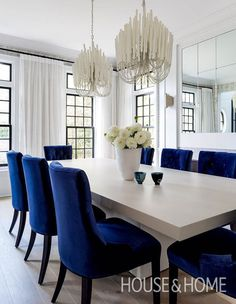 Transitional Dining Room Chandelier Unique Two White Chandeliers Over Gray Wood Dining Table Dining Room Blue, Elegant Dining Room, Dining Room Design, Silver Wallpaper Dining Room, Chandeliers For Dining Room, White Dining Rooms, White And Silver Wallpaper, Blue Velvet Dining Chairs, Luxury Dining Room