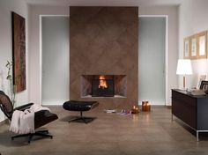 Deep, earthy, lustrous #porcelain on the floors and #fireplace facade. #UnionTiles