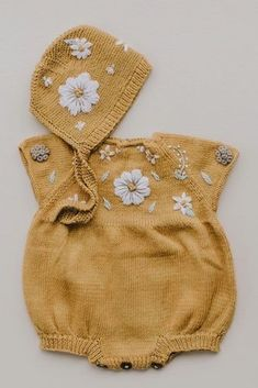 """The sweetest baby outfit. These colours - delicate but with a bit of """"pop"""" - Our Flora Cotton romper and bonnet hat in """"mustard"""". Available in different colours! Crochet Baby Clothes, Cute Baby Clothes, Baby Clothes Shops, Crochet Dresses, Knitting For Kids, Baby Knitting Patterns, Baby Boy Outfits, Kids Outfits, Winter Newborn"""