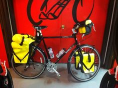 Black Surly LHT, Tubus front and rear racks, yellow Ortlieb panniers.  What Emmaline will look like when she's fully loaded (just add a white saddle and white bar tape).
