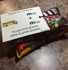 End of school year gift for bus driver.  3 packs of M&M's with a note saying... Thank You for driving me Miles & Miles to and from School!