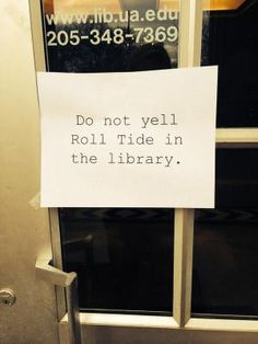 "Sign saying, ""Do not yell Roll Tide in the library."""