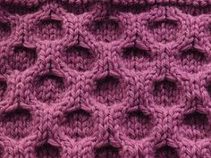 Aran #Knitting #Stitch - this all-over cabled pattern creates a cell-like structure that could be used in Aran knitting or could be the main stitch in a hat or even a handbag. It would clearly knit up as a very thick and dimensional fabric. The directions - which are given at the site when you click on the picture - are 8 rows long, but this looks really easy to memorize and to knit just by looking at your work.