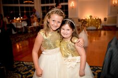 Photo by Michelle Lawson Photography. My cute little girls! My bridal party had custom made gold sequin tops, floor length dresses ♥ I was literally obsessed! #wedding #weddingideas  #flowergirldress #mstriciasfl #goldflowergirldress #bridalpartydress #goldsequinbridesmaiddress #goldsequindress #goldsequinbridalparty #flowergirls