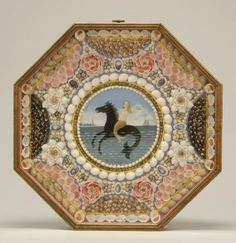 Sailor's valentine with central circular painting depicting a mermaid riding on the back of a merhorse with a lighthouse and schooner in dis...