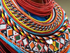 Kenya's Maasai peoples are renowned for their bodily ornamentations: their wide collars, ankle and arm bracelets, earrings, headwear, and brow bands - all beaded in a riotous array of coloured beads. Bijoux Masai, Masai Jewelry, Tribal Jewelry, Beaded Jewelry, Beaded Necklaces, Gold Jewellery, African Necklace, African Beads, African Jewelry