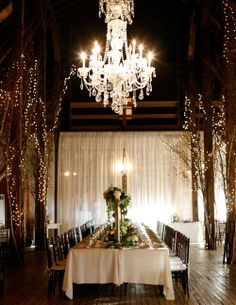 A look inside the rustic and elegant barn. Photograph by Belathee Photography.