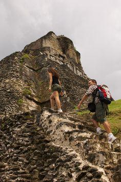 Climbing El Castillo pyramid at Xunantunich Mayan site in Belize.
