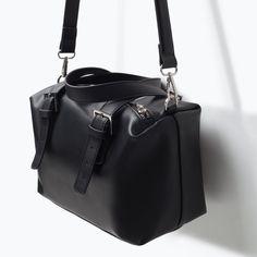 Zara's bowling bag. With a diagonal zipper