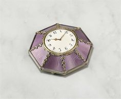 A Jeweled Two-Color Gold-Mounted Silver-Gilt And Guilloché Enamel Desk Clock, Marked K. Fabergé With The Imperial Warrant, Moscow, 1899-1908