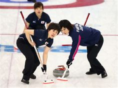 DAY 11:  Michiko Tomabechi and Yumie Funayama of Japan compete during Curling Women's Round Robin Session 11 - China vs. Japan