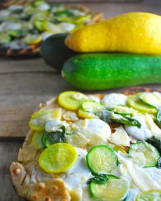 Rustic grilled pizza with zucchini, garlic, and basil leaves