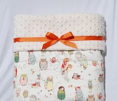"""Baby Crib Quilt -  Spotted Owl with Cream Minky Dot  36"""" x 48"""". $118.00, via Etsy.  Great wrapping idea"""