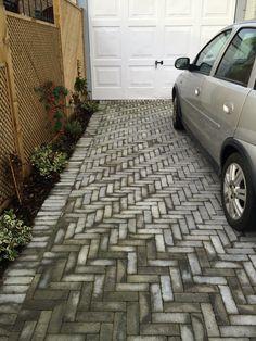 Herringbone driveway. I like the narrow bricks.