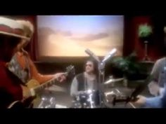 Traveling Wilburys -- Runaway (Del Shannon's song) = Great photos/video too.