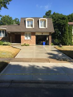 Brushed Concrete Driveway in London Ontario Driveway Ideas, Concrete Driveways, Ontario, Garage Doors, Sidewalk, London, Outdoor Decor, House, Home Decor