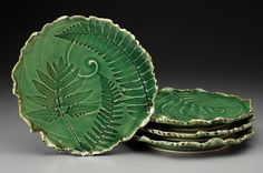 Grenadier Pottery impressed leaves fern off center spiral background pottery ceramics clay