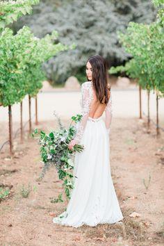 Elegant open back long sleeve wedding dress: http://www.stylemepretty.com/little-black-book-blog/2016/02/03/rustic-elegant-fall-wedding-at-chateau-st-jean/ | Photography: Koman Photography - http://komanphotography.com/