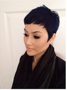 1920s inspired pixie cut with long sideburns.  Very fashion forward!