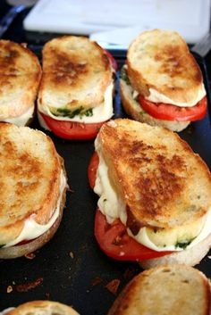 Fresh bread with thinly sliced mozzarella, garden tomatoes, homemade pesto and a drizzle of olive oil. Grill