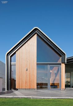 Siberian larch accents the facade of this weekend and vacation house. Photography by David Barbour.