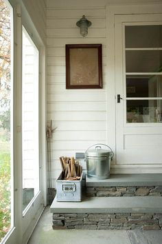 """The back porch door connects the dining room to the closed back porch. """"On her first visit, our friend CoCo turned this old frame into [a] piece of art after a walk around the property cutting ferns,"""" Ted KW says. """"It makes us smile and think of her."""""""