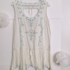 Free People Top Light and airy Free People top; great embroidered details; 100% cotton; size small; NWOT; never been worn Free People Other