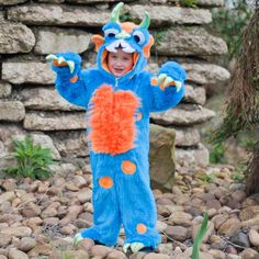 A plush monster costume with shaggy blue and orange fur and green foil horns with soft claws Great for dressing up parties or to wear as a onesie