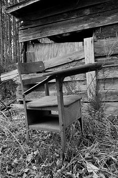 old desk...  there was an old school house behind our house next to a grave yard.  There were a few old desks outside.  This reminds me so much of how it looked.