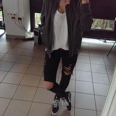 Olive cargo jacket, white shirt, black ripped jeans, vans