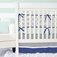 A deep shade of navy, sweet mint, and gray come together in our designer navy and mint baby bedding.