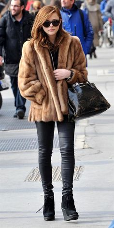 Chloe Moretz in a mink fur coat.