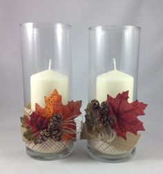 Inexpensive fall candles.  I picked up the candles & glass vases from IKEA, then hot glued some paper, burlap ribbon, baker's twine, silk leaves (from the Dollar Tree store), and mini pine cones.  Set these out on a table with a strand or two of the fall leaves and some gourds to make a lovely table centerpiece.