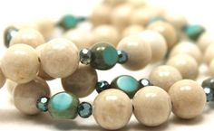 23 inches long ivory beige sea sediment jasper, iridescent blue crystals and three sided turquoise Czech glass lampwork necklace and earrings set