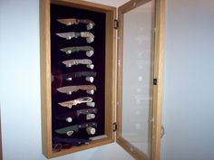 Wall mounted knife display case