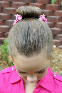 I am so not the mom that does this kind of thing. But it really does look easy.  Little Girls Hairdos: Pretty Toddler Ballet Buns