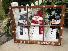 Snowmen in window pane