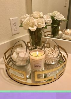 IM OBSSED with the bathroom piece I put together. -Gold Tray: kirklands -Glass … IM OBSSED with the bathroom piece I put together. -Gold Tray: kirklands -Glass containers: TJ Max -Candle: target Source by Bathroom Countertops, Bathroom Cabinets, Countertop Decor, Organize Bathroom Countertop, Restroom Cabinets, Bathroom Organization, Bathroom Storage, Organization Ideas, Makeup Vanity Organization