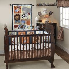 Ok, I'm being indecisive. I think I like this set better than the Team Safari set that we found at Babies-R-Us. This might be the set we go with...  Bedtime Originals Teammates 4 Piece Bedding Set, http://www.amazon.com/dp/B004Q7MSPI/ref=cm_sw_r_pi_awd_aOx6rb041Q005