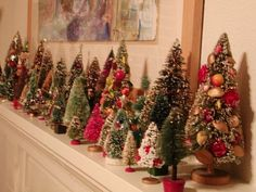 In need a mini christmas tree forest for the mantel! DECK THE HOLIDAY'S: VINTAGE CHRISTMAS DECORATIONS AND TREES!
