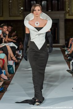 Lenie Boya S/S 2015 London Fashion Week Haute Couture. Black dress with futuristic white calla lily inspired jacket.