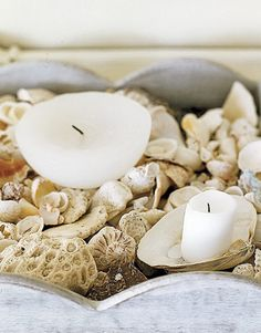 A bowl of small shells makes an elegantly simple votive holder.