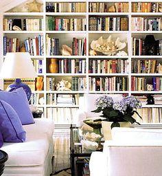 Organized bookshelves. Nice! Iwould just change piloes dark pink/ raspberry colour :)